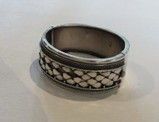 A Victorian silver hinged bangle with concealed cl