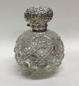 A good silver mounted hobnail cut scent bottle wit