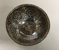 A Continental chased silver bowl. Marked to centre
