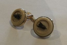 A pair of unusual ivory and gold cufflinks inset w
