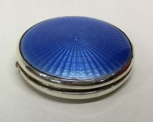 A silver and blue enamelled circular compact. Birm