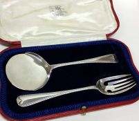 A cased pair of feather edge pattern silver server
