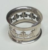 A good quality silver napkin ring decorated with c