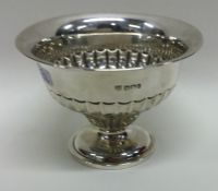 An Edwardian silver sugar bowl of half fluted desi