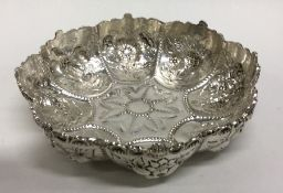A heavy cast silver shaped bonbon dish profusely d