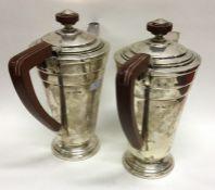 A pair of Art Deco silver tapering café au lait po