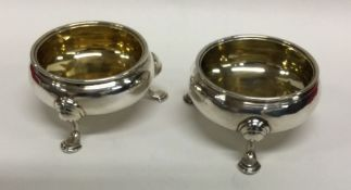 A pair of George II silver salts with gilt interio