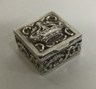 A chased silver box with embossed decoration/. App
