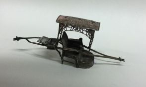A Continental silver model of a carriage with fili