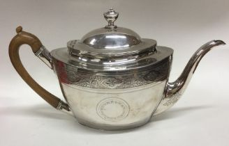 A good Georgian boat shaped silver teapot with eng