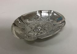A heavy Continental Antique silver dish decorated