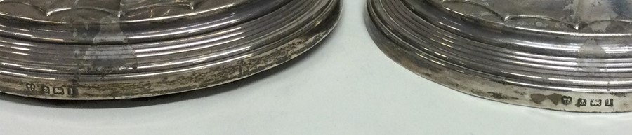 A pair of large tapering silver candlesticks. Birm - Image 2 of 2