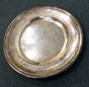 A large silver plated armada dish engraved with a