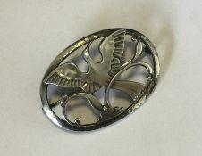 GEORG JENSEN. A stylish oval silver brooch in the