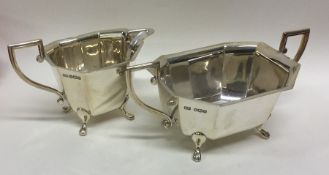 An Edwardian silver cream jug together with matchi