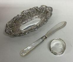 An Edwardian silver bonbon dish, napkin ring etc.