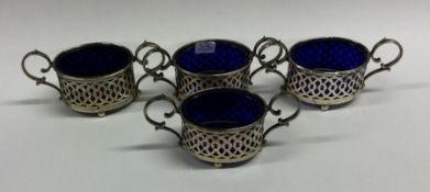 A set of four Edwardian silver salts with BGLs. Bi