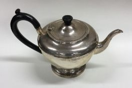 An Edwardian silver teapot of circular form. Birmi