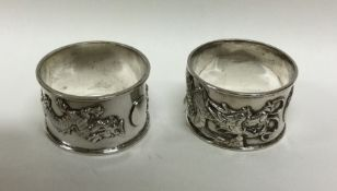 A good pair of chased silver napkin rings decorate