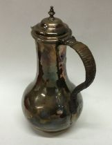 A George II baluster shaped silver jug with cane h