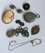 A bag containing silver medallions, cameo etc. App