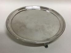 A Georgian silver salver of circular form on sprea