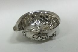 A small silver bowl / jug decorated with flowers.
