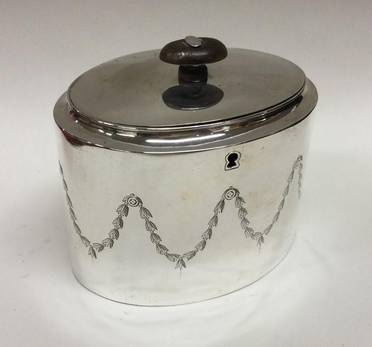 A good George III silver tea caddy with scroll dec