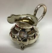 RUSSIAN: An attractive silver cream jug with cast