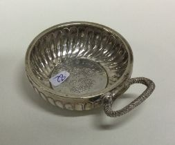 An Antique silver wine taster with scroll decorati