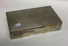 A silver engine turned cigarette box with hinged l
