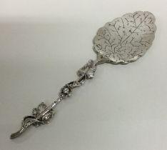 A large Continental cast silver preserve spoon. Ap