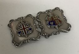 A silver and enamelled buckle with scroll decorati