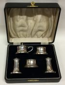 A cased five piece silver and bakelite cruet. Birm