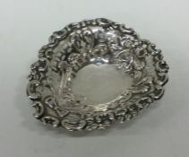 A small pierced silver bonbon dish of heart shaped