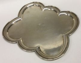 An unusual six sided silver salver with crested ar
