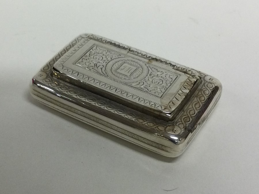A George III bright cut silver snuff box with hing