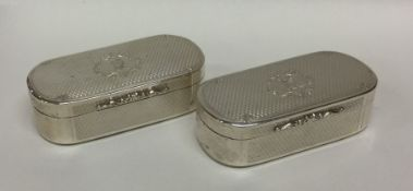 A good pair of heavy crested silver snuff boxes of