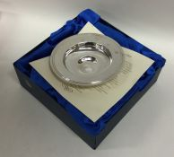 An Edwardian silver armada dish contained within a