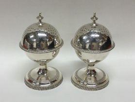 A good pair of heavy silver globular peppers with
