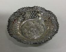 A circular Edwardian silver bonbon dish decorated
