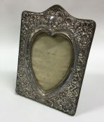 A silver mounted heart shaped picture frame. Birmi