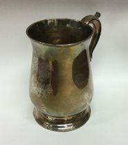 A heavy George III silver mug on spreading foot. L