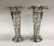 A pair of Edwardian silver tapering spill vases wi
