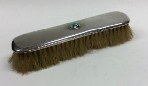 LIBERTY & CO: A silver mounted hairbrush inset wit