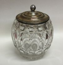 A silver and cut glass biscuit barrel with lift-of