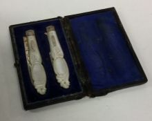 A good pair of cased silver fruit knives with MOP