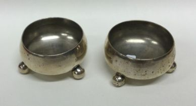 A pair of Victorian silver cylindrical salts on ba
