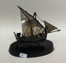 A Continental silver model of a boat on ebony base