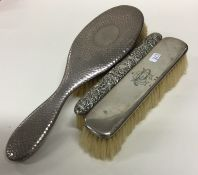 A group of three silver mounted brushes. Various d